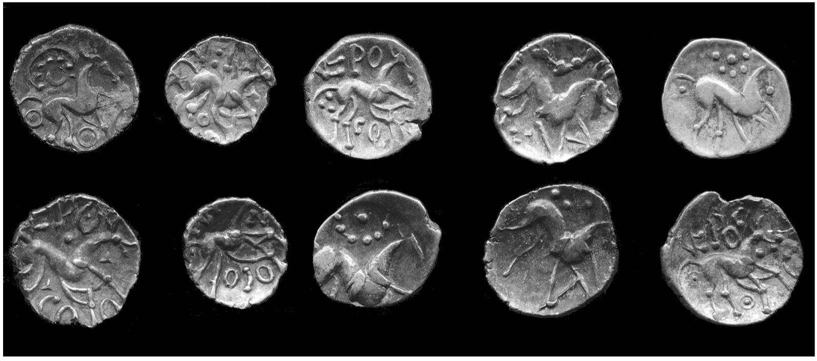 A black and white photo of ten coins, all stamped with the image of a horse surrounded by different arrangements of dots and characters.