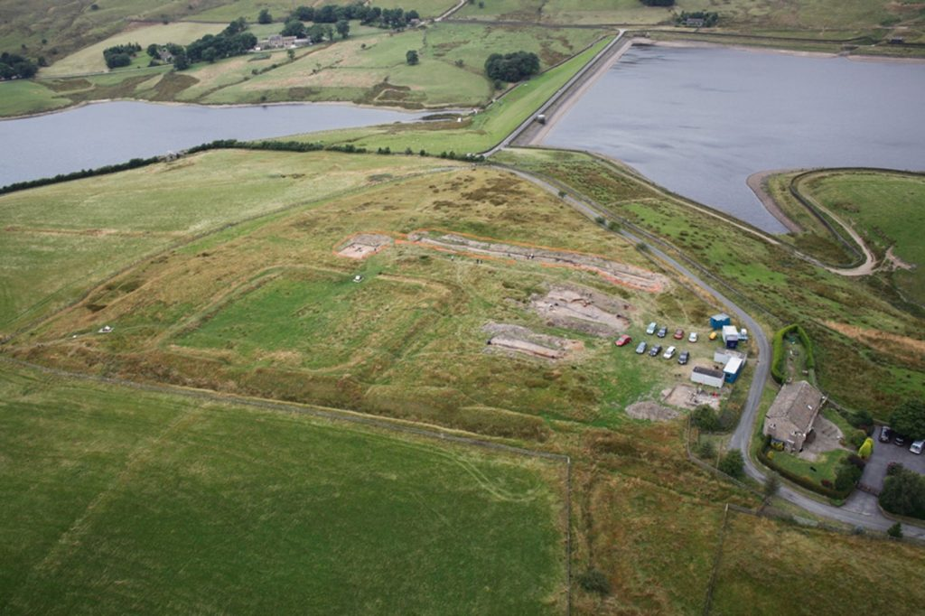 An aerial photograph of the remains of Castleshaw Roman Fort being excavated.