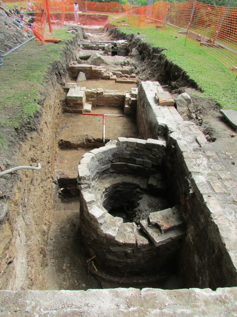 Image of an excavation trench with post medieval remains of visible