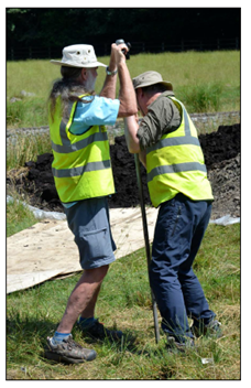 Photograph of two people undertaking coring