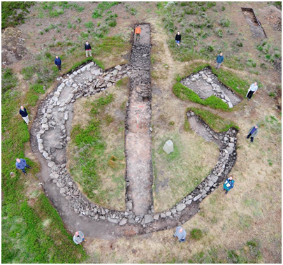 Aerial photograph of a cairn being excavated