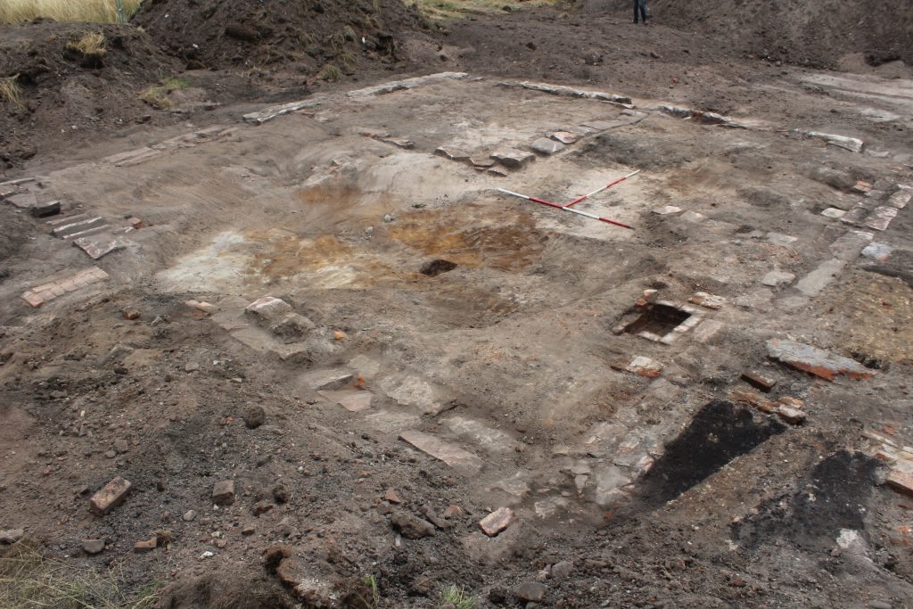 Photograph of the stone foundations of a building uncovered on an archaeological excavation