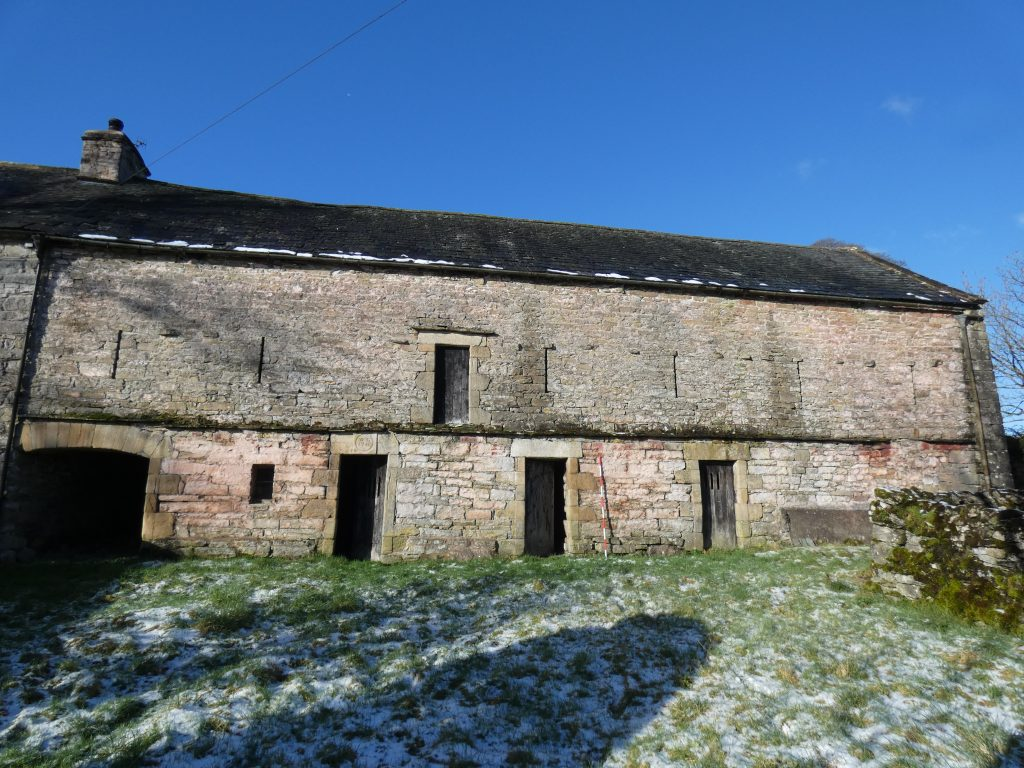 Photograph of a stone barn building