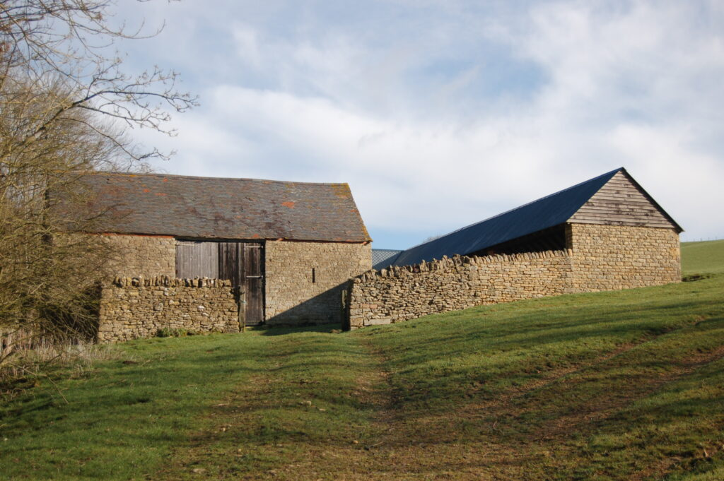 An outfarm near Conderton, comprised of a threshing barn and shelter shed facing a cattle yard. Photo © Worcestershire County Council